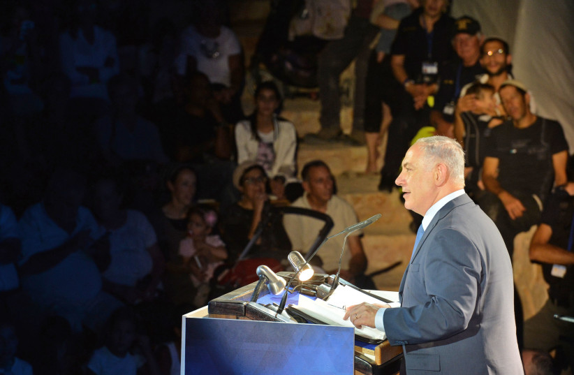 Prime  Minister Benjamin Netanyahu delivers a speech marking 50 years of Israeli presence in the Jordan Valley  (photo credit: KOBI GIDEON/GPO)