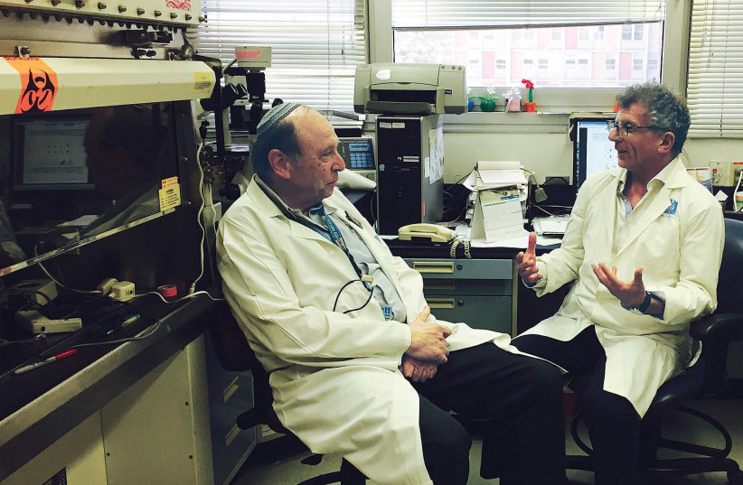 Prof. Reuven Or, from the Bone Marrow Transplantation and Cancer Immunotherapy Research Center, speaks with Pluristem CEO Zami Aberman last month. (photo credit: PLURISTEM)