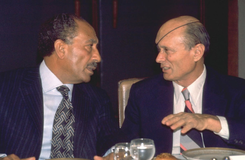 Sadat chatting with foreign minister Moshe Dayan during a dinner at the King David Hotel (photo credit: YAACOV SAAR/GPO)