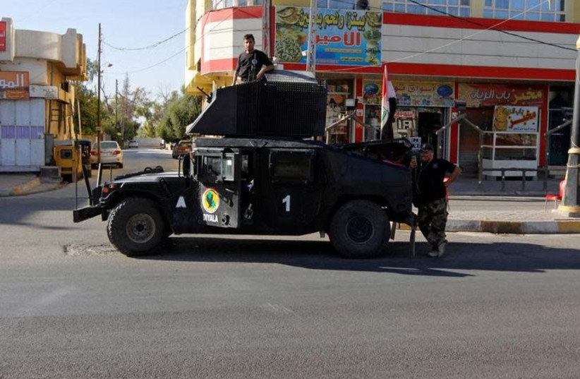 A vehicle of the Iraqi Federal police is seen on a street in Kirkuk, Iraq October 19, 2017. Picture taken October 19, 2017. (photo credit: REUTERS/AKO RASHEED)