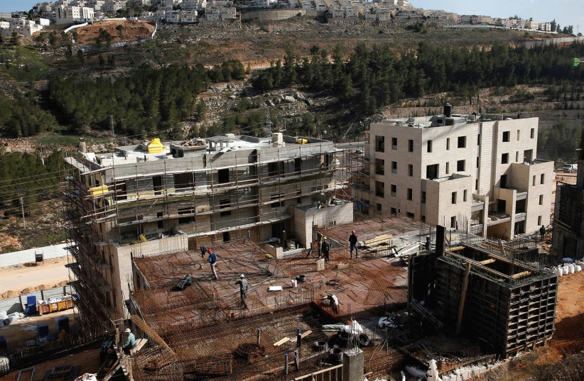 A VIEW of the Jerusalem neighborhoods of Ramot (foreground) and Ramat Shlomo (background). (photo credit: REUTERS)