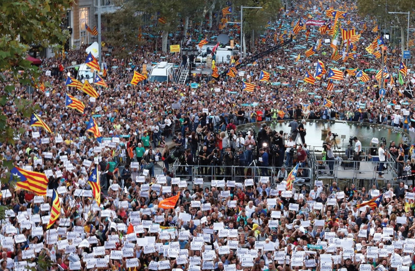CATALANS MARCH for independence on Saturday  (photo credit: REUTERS)