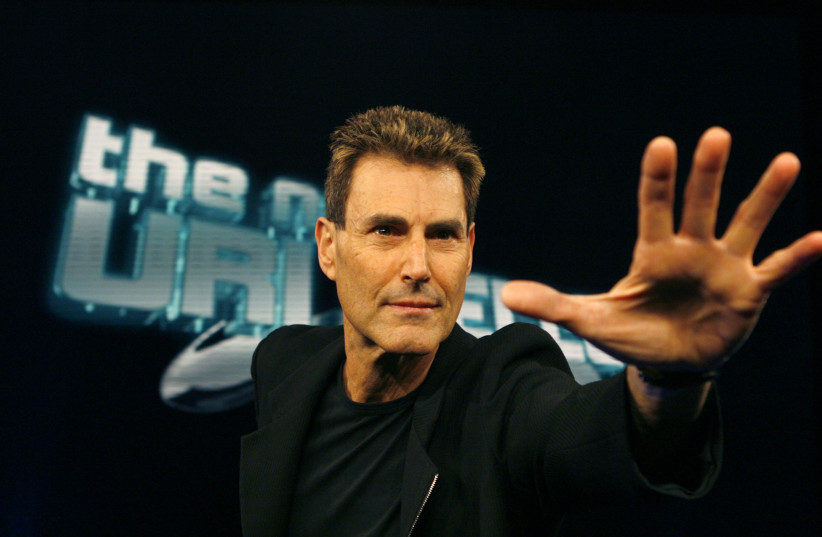 Israeli psychic Uri Geller poses for photographers in Cologne (photo credit: REUTERS/INA FASSBENDER)