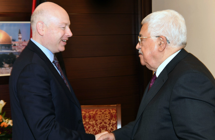 US President's envoy to the Middle East Jason Greenblatt meeting with Palestinian Authority President Mahmoud Abbas (photo credit: AFP PHOTO / PPO / THAER GHANAIM)