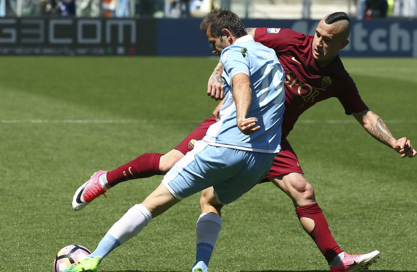 A match between Lazio and AS Roma  (photo credit: REUTERS/ALESSANDRO BIANCHI)