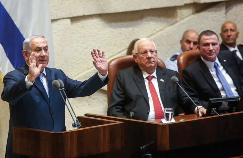 Prime Minister Benjamin Netanyahu delivers a speech at the Knesset Monday. (photo credit: MARC ISRAEL SELLEM)