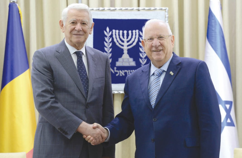 President Reuven Rivlin (right) receives Romanian Foreign Minister Teodor Melescanu at the President's Residence yesterday. (photo credit: Mark Neiman/GPO)