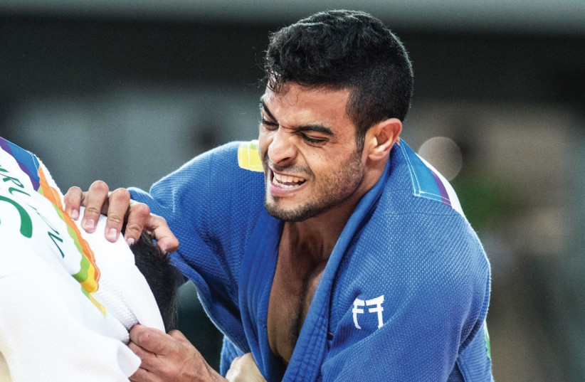 Israeli Judoka Sagi Muki will return to Ben-Gurion Airport today with the blue-and-white delegation in the hope of finally departing for Abu Dhabi, where they are set to compete in the Grand Slam event that starts on Thursday. (photo credit: ASAF KLIGER)