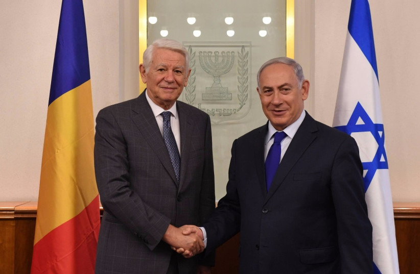 Prime Minister Benjamin Netanyahu meets with Romanian Foreign Minister Teodor Melescanu. (photo credit: CHAIM TZACH/GPO)