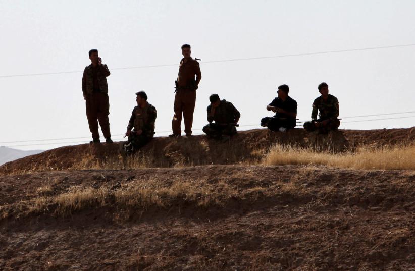 Kurdish Peshmarga forces are seen near Altun Kupri, between Kirkuk and Erbil (photo credit: AZAD LASHKARI / REUTERS)