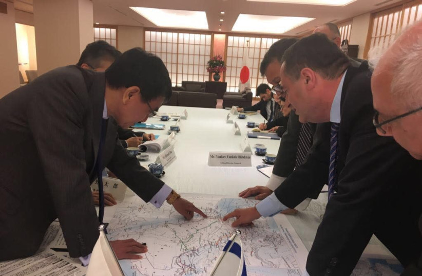 Intelligence and Transportation Minister Israel Katz with Japanese Foreign Minister Taro Kono, October 24, 2017.  (photo credit: INTELLIGENCE AND TRANSPORTATION MINISTER ISRAEL KATZ'S SPOKESPERSON'S UNIT)