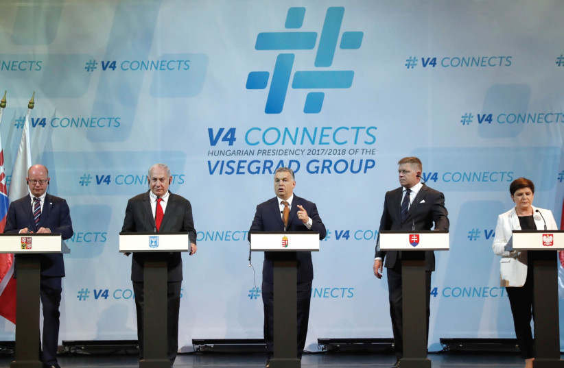 Prime Minister Benjamin Netanyahu, Visegrad Group (V4) Prime Ministers, Czech Republic's Bohuslav Sobotka (L), Hungary's Viktor Orban (C to R), Slovakia's Robert Fico and Poland's Beata Szydlo attend a news conference in Budapest, Hungary in July. (photo credit: REUTERS)