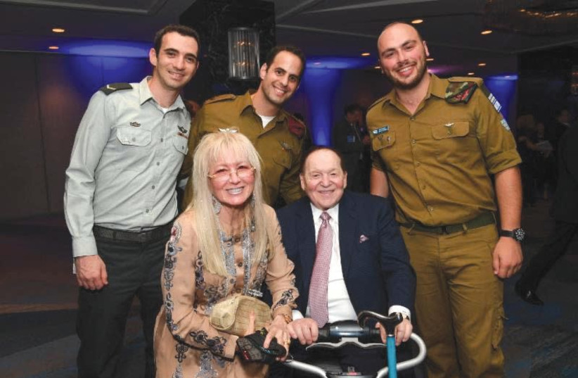 MIRIAM AND Sheldon Adelson pose with IDF soldiers in New York. (photo credit: SHAHAR AZRAN)