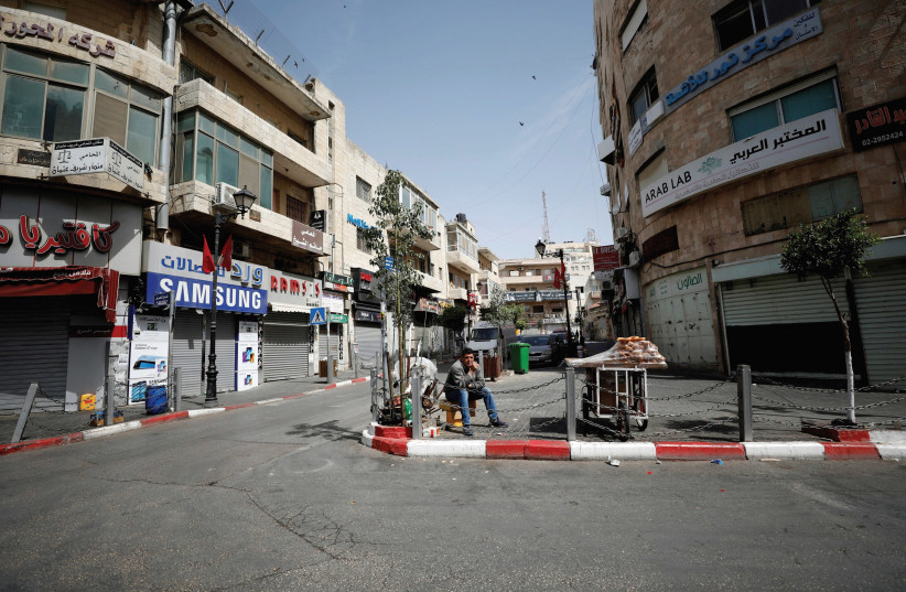 A STREET in Ramallah. The Palestinian economy is suffering. (photo credit: REUTERS)
