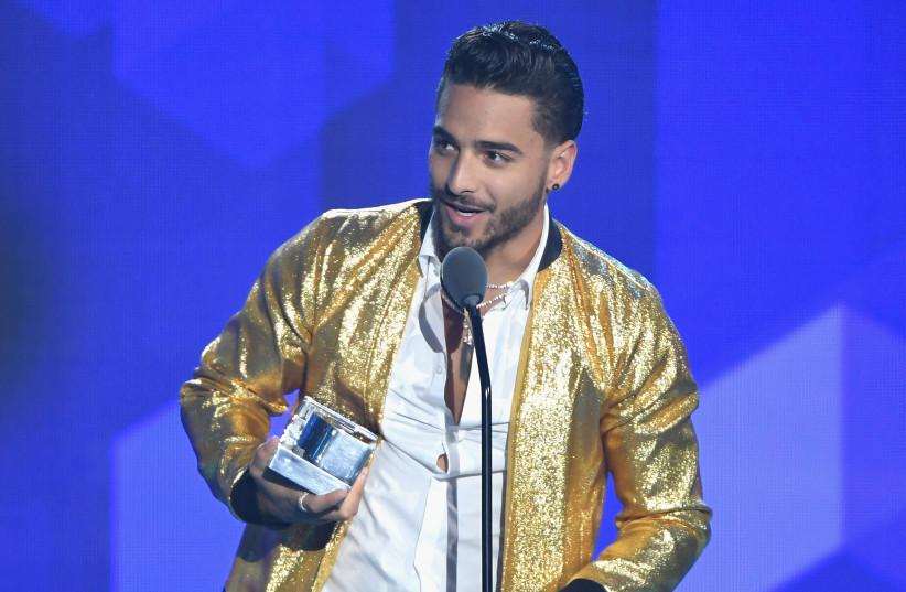"Maluma accepts an award on stage during Univision's ""Premios Juventud"" 2017 (photo credit: RODRIGO VARELA / GETTY IMAGES NORTH AMERICA / AFP)"