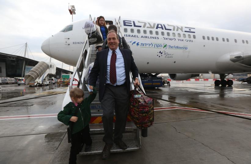 Rabbi Yechiel Eckstein, founder of the International Fellowship of Christians and Jews, disembarks a plane bringing olim from Ukraine (photo credit: MARC ISRAEL SELLEM)
