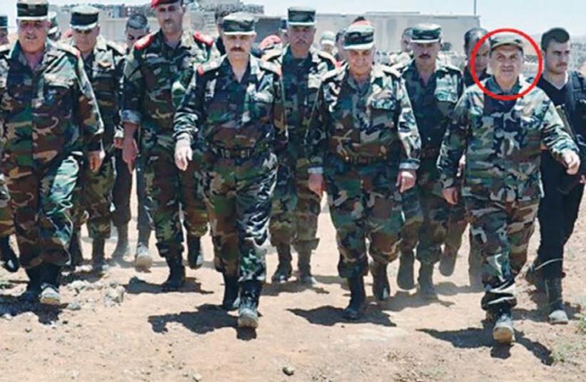MUNIR ALI NAIM SHAITI (circled) has been identified as Hezbollah's leader on the eastern Golan Heights.  (photo credit: ARAB MEDIA)