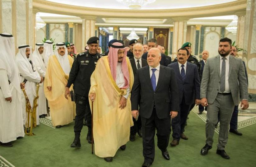 Saudi Arabia's King Salman bin Abdulaziz Al Saud and Iraqi Prime Minister Haider al-Abadi arrive for a meeting in Riyadh, Saudi Arabia October 22, 2017. (photo credit: SAUDI PRESS AGENCY/HANDOUT VIA REUTERS)