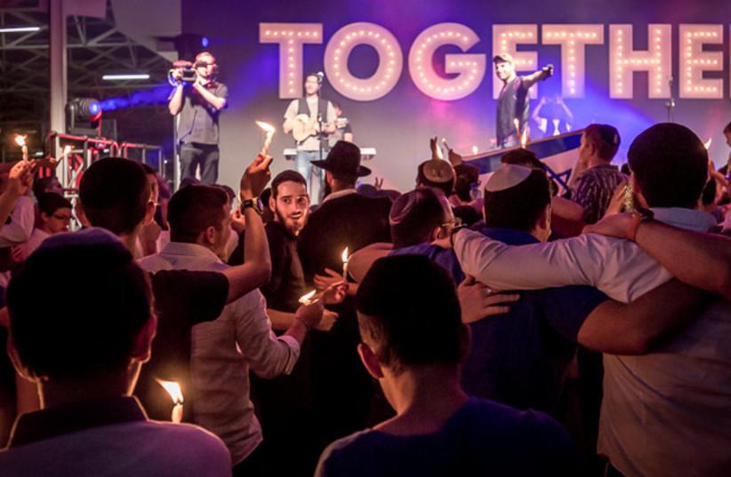A community in Johannesberg participates The Shabbat Project with a havdallah celebration (photo credit: THE SHABBAT PROJECT)