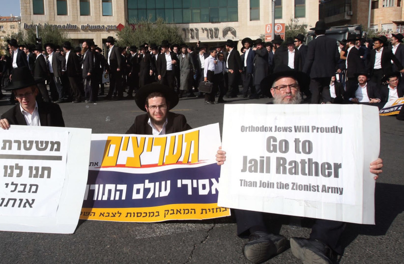 ULTRA-ORTHODOX protesters hold signs in Jerusalem during their 'day of rage,' declared to protest the arrest of two draft-dodging yeshiva students. (photo credit: MARC ISRAEL SELLEM/THE JERUSALEM POST)