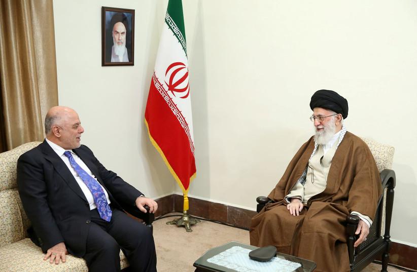 Iran's Supreme Leader Ayatollah Ali Khamenei meets with Iraqi Prime Minister Haider Al-Abadi in Tehran, Iran (photo credit: LEADER.IR/HANDOUT VIA REUTERS)
