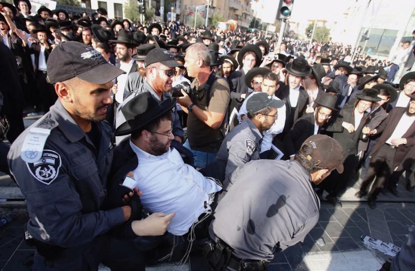 POLICE APPREHEND a man during last week's 'day of rage' protest in Jerusalem. (photo credit: MARC ISRAEL SELLEM/THE JERUSALEM POST)