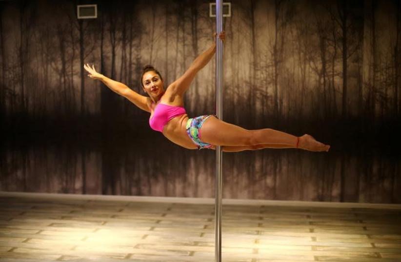Pole dancer. (photo credit: REUTERS/IVAN ALVARADO)