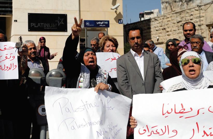 PALESTINIANS PROTEST the Balfour Declaration in Ramallah last week.  (photo credit: MOHAMAD TOROKMAN/REUTERS)