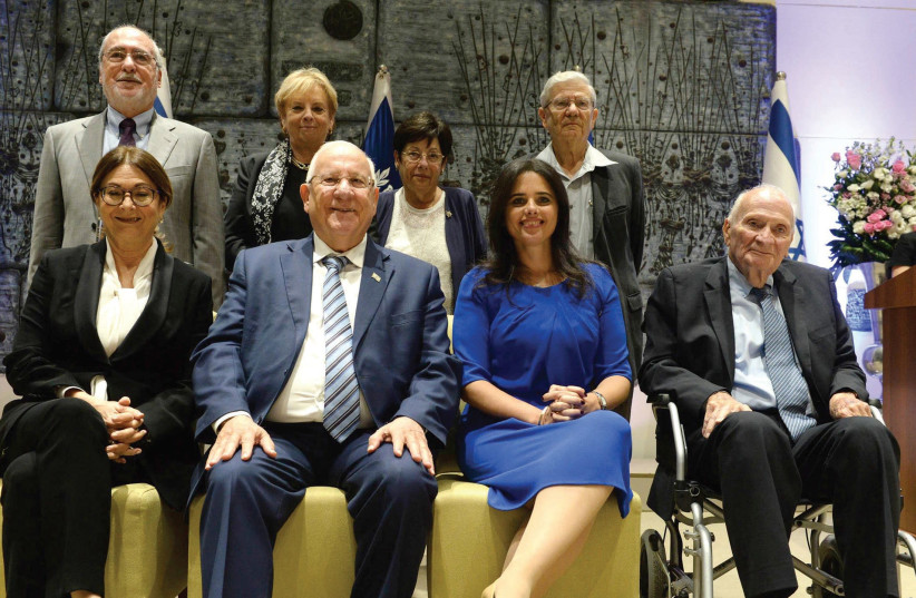 INCOMING SUPREME COURT President Esther Hayut (lower-left) poses yesterday with President Reuven Rivlin (photo credit: MARK NEYMAN / GPO)