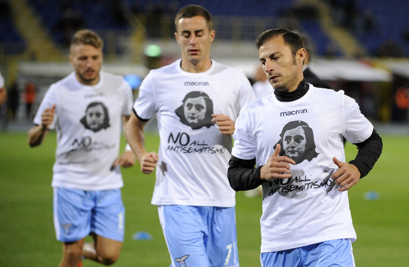 SS Lazio players sport t-shirts with Anne Frank's face on them in an effort to stamp out antisemitism at matches (photo credit: MARCO ROSSI/ GETTY IMAGES)