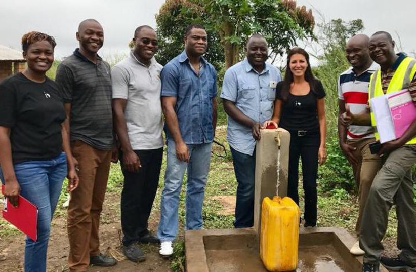 A member of Israel's Innovation: Africa team installs clean water for a refugee village in Central Africa earlier this year.  (photo credit: INNOVATION:AFRICA)