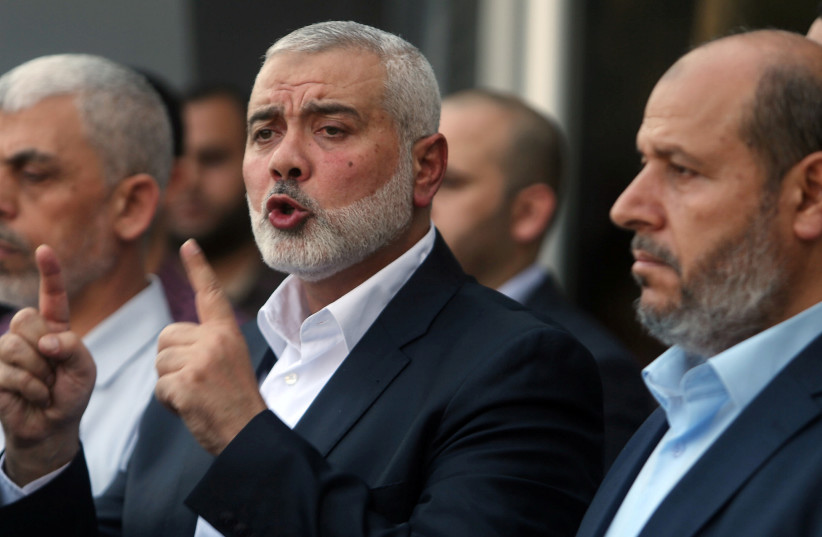 Hamas Chief Ismail Haniyeh gestures during a news conference following his arrival at the Rafah border crossing in the southern Gaza Strip September 19, 2017.  (photo credit: REUTERS)