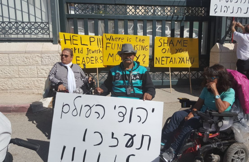 Protesters with disabilities call on the Jews of the world to help during a rally outside the Prime Minister's Office (photo credit: COURTESY OF DISABLED STRUGGLE CAMPAIGN)