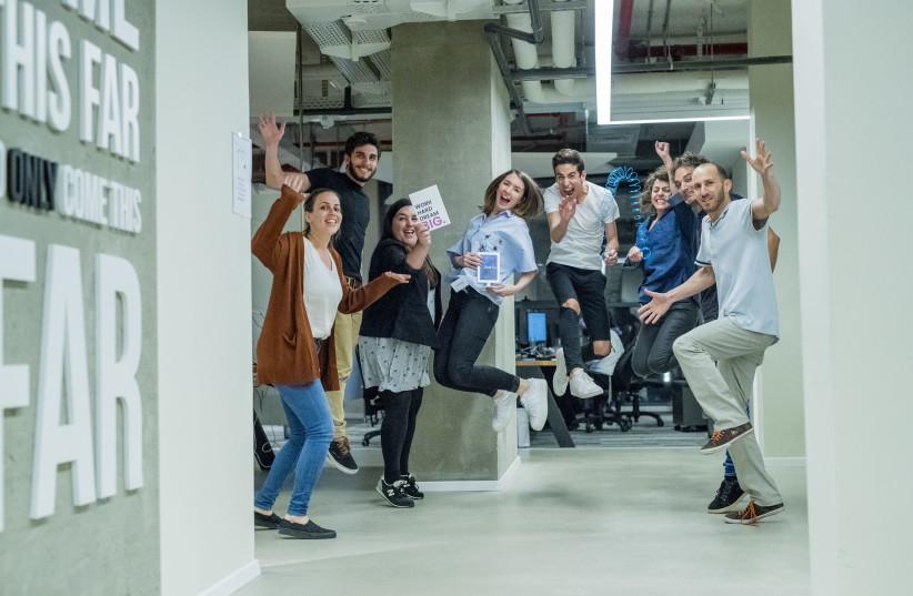 Employees at Israeli digital entertainment platform Playbuzz take part in an all-night hackathon. Courtesy: Playbuzz (photo credit: Courtesy)