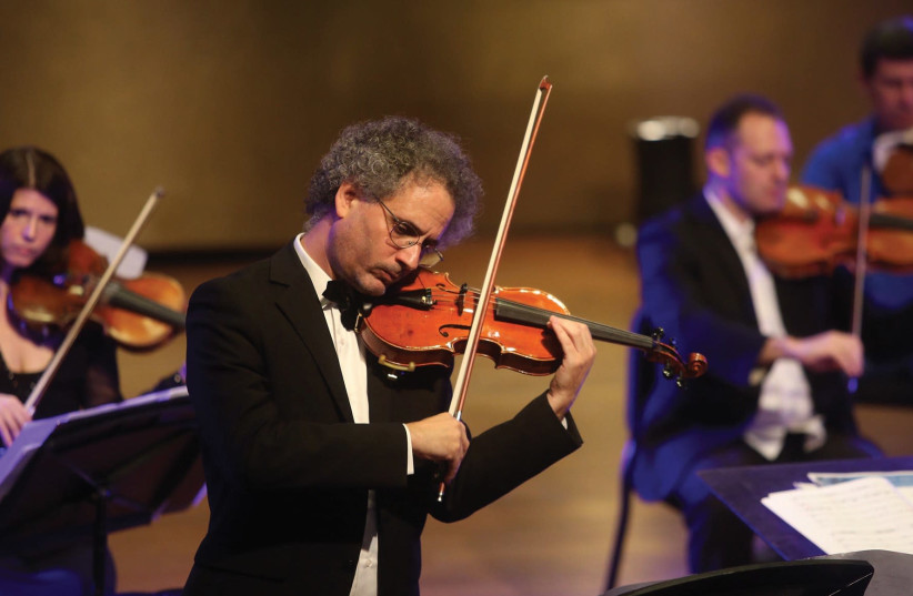 Matan Dagan plays a violin, which was lost in France during the Holocaust (photo credit: MARC ISRAEL SELLEM/THE JERUSALEM POST)
