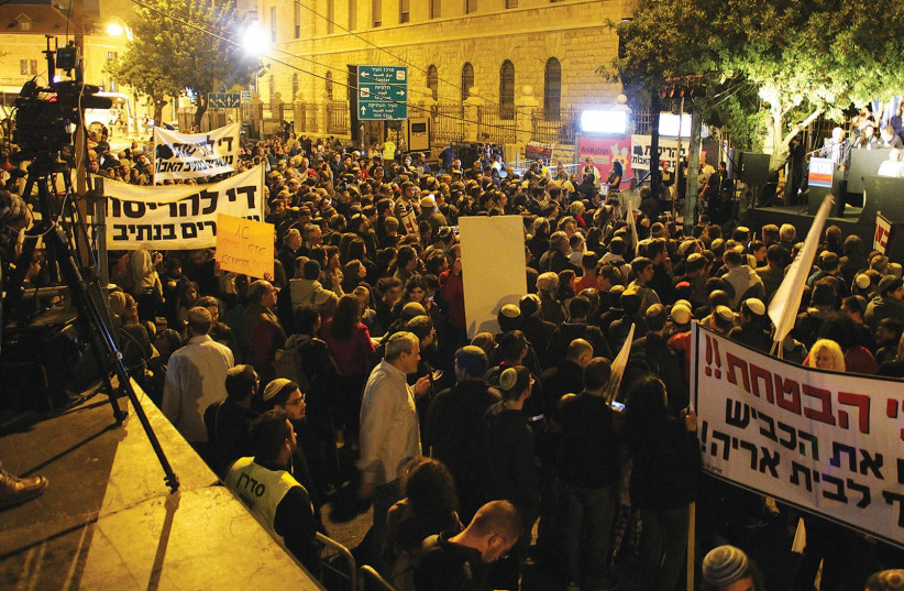 POLITICIANS AND protesters hold a rally in front of Prime Minister Benjamin Netanyahu's Jerusalem home last night calling on him to authorize money that was promised for security to prevent further terrorist attacks. (photo credit: TOVAH LAZAROFF)