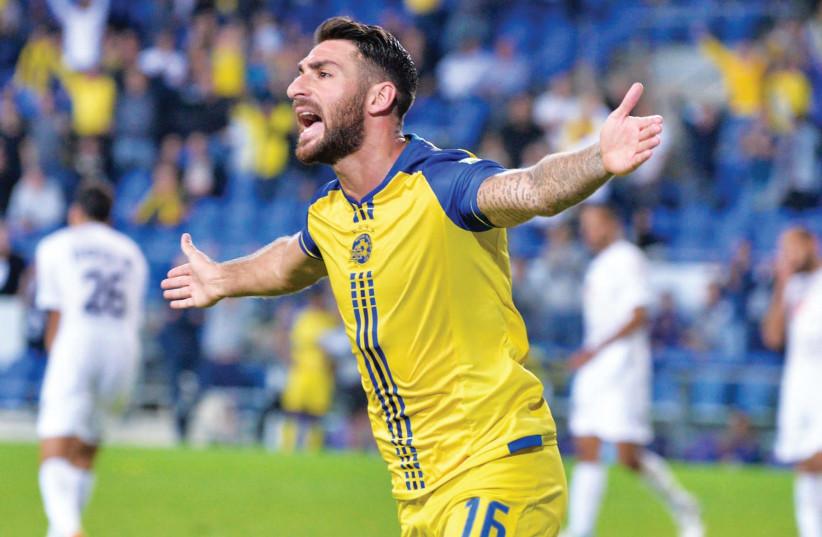 Maccabi Tel Aviv striker Eliran Atar celebrates after scoring his third goal during last night's 5-2 win over Hapoel Acre in Netanya. (photo credit: ARIEL SHALOM)