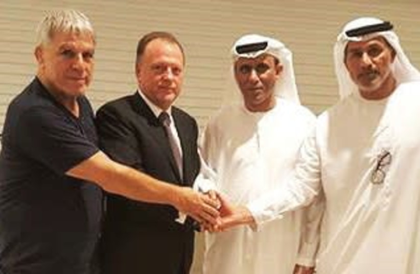 Israel Judo Association chairman Moshe Ponte (far left) poses with International Judo Federation President Marius Vizer, President of the UAE Judo Federation Mohammad Bin Thaloub AL Darei and UAE Judo, Wrestling and Kickboxing Federation General Secretary Naser AL-Tameemi after they met on Saturday  (photo credit: INTERNATIONAL JUDO FEDEREATION/COURTESY)