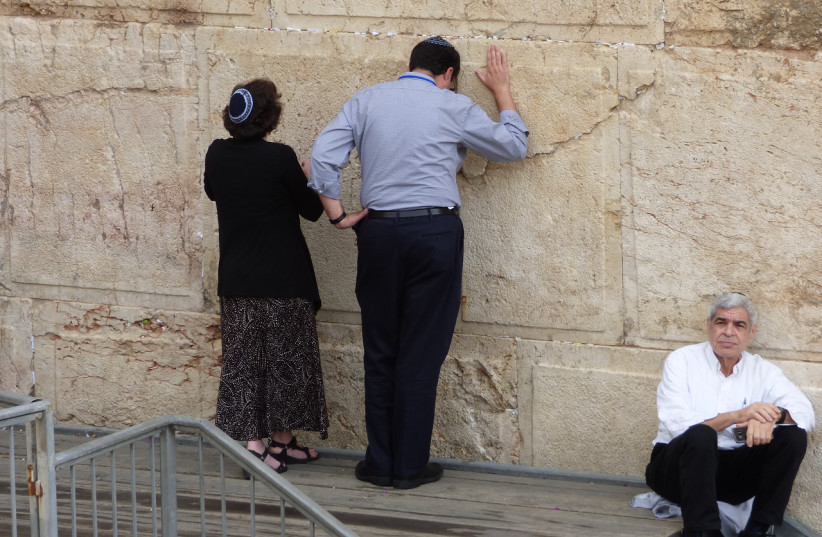 A man and woman pray at the egalitarian section of the Western Wall (photo credit: DAVID SHECHTER FOR THE JEWISH AGENCY FOR ISRAEL)