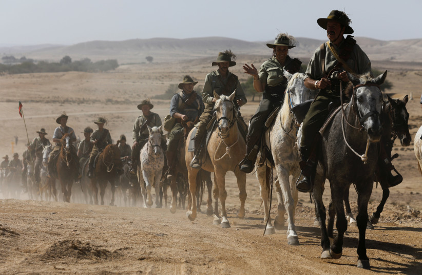 Descendants of soldiers from the Australian and New Zealand Army Corps (ANZAC), ride horses along the trail that their ancestors took as troops when they made their way to Beersheba. (photo credit: REUTERS)