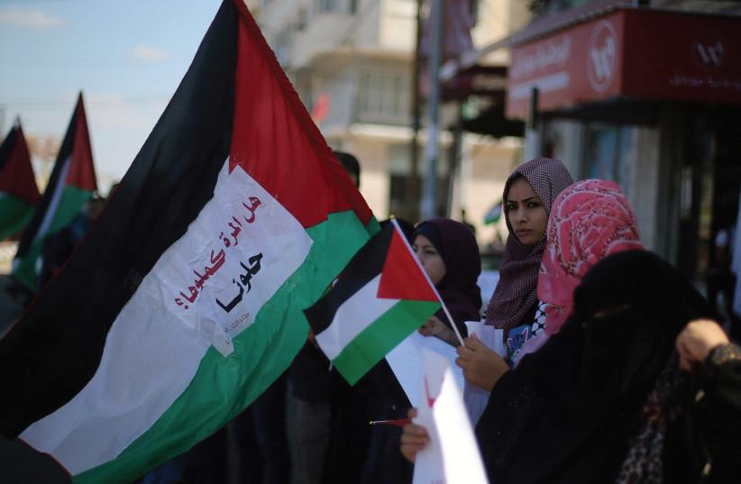 WOMEN WAVE flags celebrating Palestinian unity.  (photo credit: REUTERS)