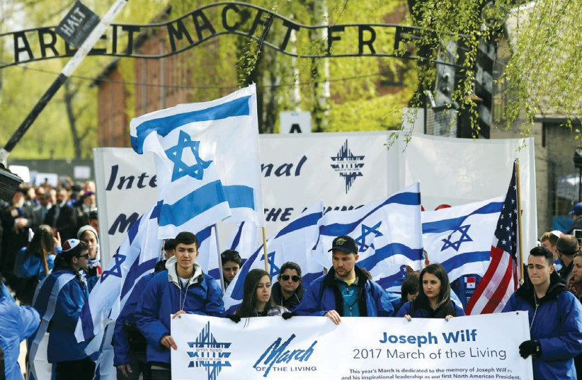 March of the Living particpants outside the gates of Auschwitz (photo credit: AGENJCA GAZETA/ REUTERS)