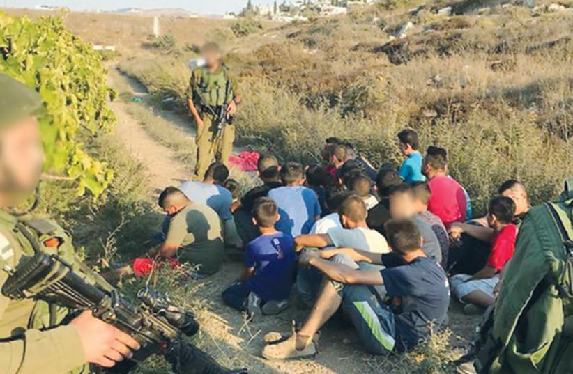 Police arrest Palestinian trespassers on Moshav Shekef (photo credit: ISRAEL POLICE)