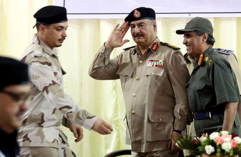 Libya's eastern-based commander Khalifa Haftar salutes as he participates in General Security conference, in Benghazi, Libya, October 14, 2017 (photo credit: REUTERS/ESAM OMRAN AL-FETORI)