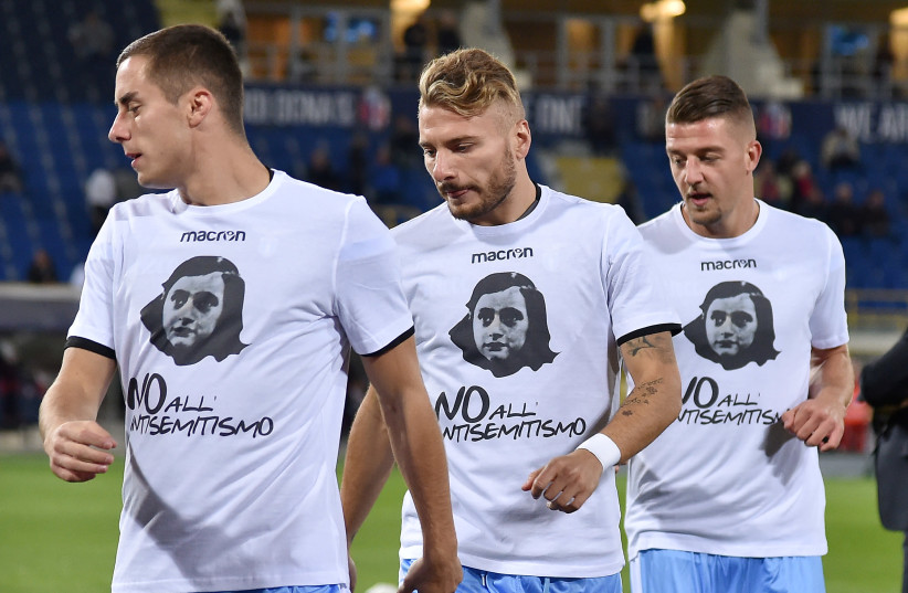Lazio players wear shirts with a picture of Anne Frank before their Serie A soccer match against Bologna at the Dall'Ara stadium in Bologna, Italy. (photo credit: REUTERS/ALBERTO LINGRIA)