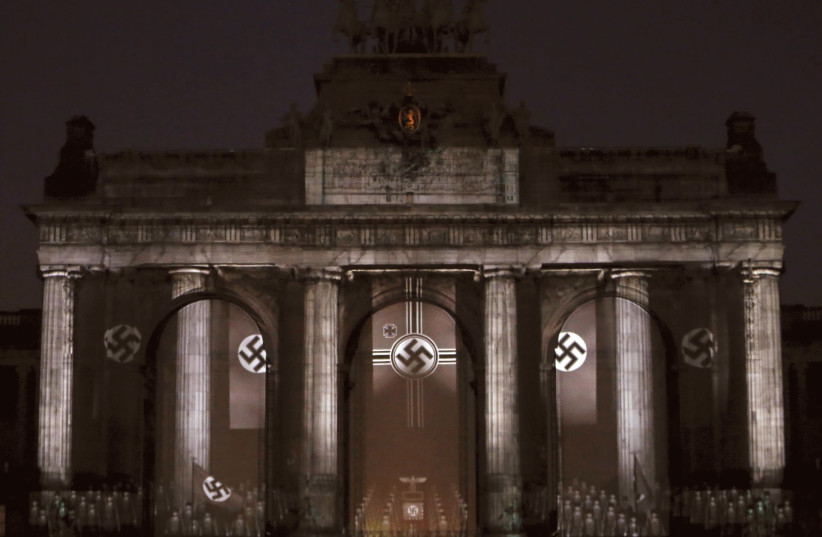 Swastikas displayed in Brussels as part of a light show recalling the Nazi era. (photo credit: REUTERS/FRANCOIS LENOIR)