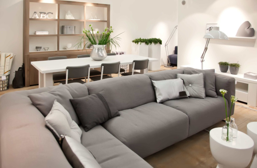 Consider placing the sofa set in the corner of the room to preserve space and emphasize the room's fresh look (photo credit: SHUTTERSTOCK)