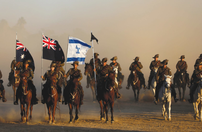 Members of the Australian Light Horse Association take part in a reenactment of the famous World War I cavalry charge known as the 'Battle of Beersheba' yesterday as part of the centenary commemorations in the southern city. (photo credit: RONEN ZVULUN / REUTERS)