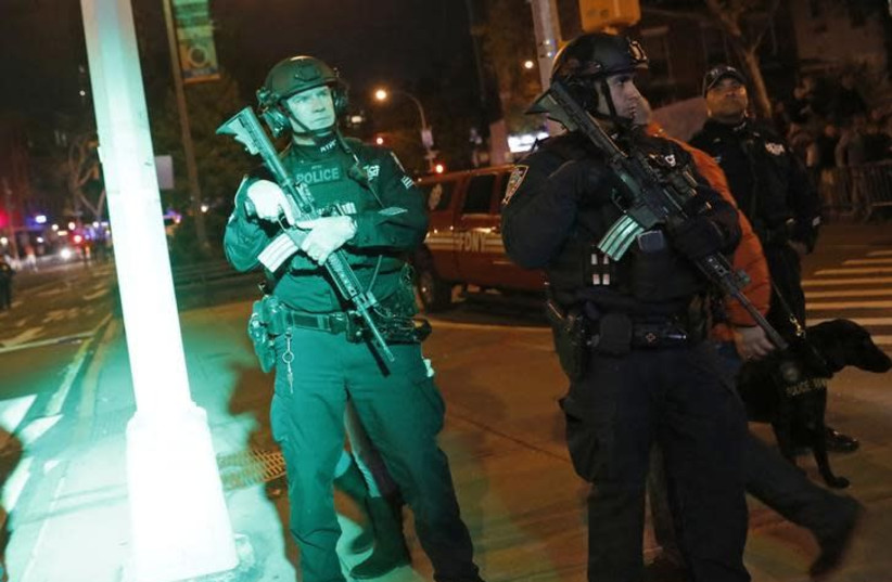 Heavily armed police officers guard the New York City Halloween parade after an earlier shooting in New York City, US October 31, 2017. (photo credit: REUTERS/SHANNON STAPLETON)