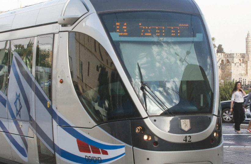 The Jerusalem light rail celebrated the 50th anniversary of the capital city's reunification last summer by decorating its trains with Israeli flags and banners. (photo credit: MARC ISRAEL SELLEM/THE JERUSALEM POST)